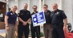 Janesville stations help community - Dormie Roberts, Blain's Farm & Fleet; Sgt Nick Brown, Rock County Sheriff's Dept, Mike O'Brien, WCLO-WJVL; Ken Scott, WCLO-WJVL; Chief David Moore, Janesville Police Dept.