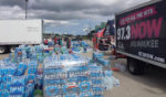 Milwaukee radio stations collect five trucks of bottled water for flood victims
