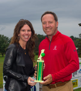 Leigh Murphy presenting the Mr. Lucky trophy to Jeff Curtis