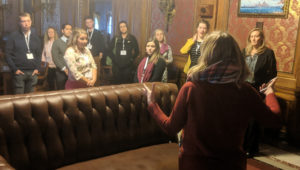 Jessica Arp providing a tour of the State Assembly Parlor